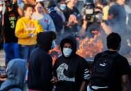 مينيسوتا تستدعي الحرس الوطني لإخماد اضطرابات أشعلتها وفاة رجل أسود